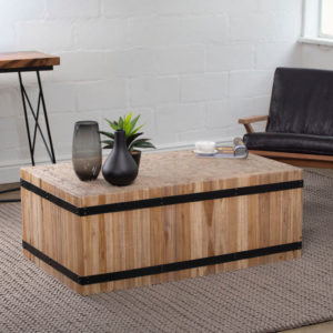 The Chesney coffee table is crafted from teak wood with metal decorative detail. Impressive in any setting with its modern, yet rustic simplicity.